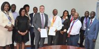 CEO Amos Wangora (right) and Global Alliance for Trade Facilitation Project Lead Markus Wauschkuhn exchange the partnership agreement